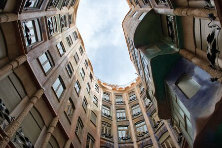 Low Angle View of Interior Courtyard, Looking Up at Blue Sky from Inside Casa Mila, Barcelona, Spain