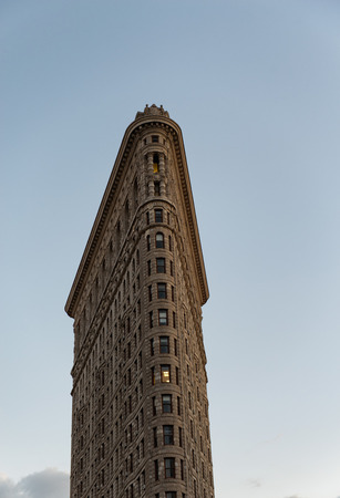 flatiron: The iconic Flatiron Building on 5th Avenue , New York City, USA, against a sunny blue sky, a popular tourist landmark conceptual of travel