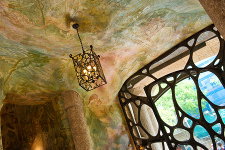 ceiling: Detail of Hanging Ceiling Lamp and Ornate Gate Inside Casa Mila with Painted Ceilings, Barcelona, Spaing