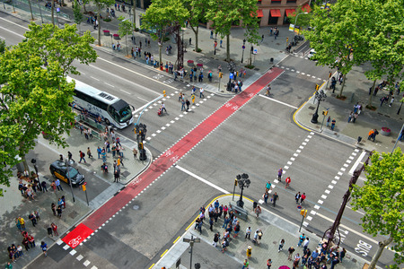 urban road: Looking Down at Busy Street Intersection with Pedestrian Cross Walks, as seen from Casa Mila, Barcelona, Spain Editorial