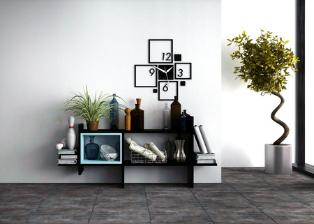 Wall-mounted shelves with personal effects and a designer clock in a modern living room interior with a potted spiral twist topiary tree side lit by daylight from a window Stockfoto