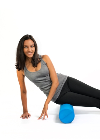 describes: Young woman doing Fascia Muscle Training with a Fascia Roll. Fascia Training describes movement exercises that attempt to improve the functional properties of the muscular connective tissues.