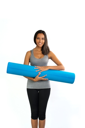 describes: Young woman ready to do Fascia Training holding a Fascia Roll. Fascia Training describes sports activities that attempt to improve the functional properties of the muscular connective tissues.