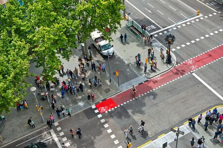 city traffic: Looking Down at Busy Street Intersection with Pedestrian Cross Walks, as seen from Casa Mila, Barcelona, Spain Editorial