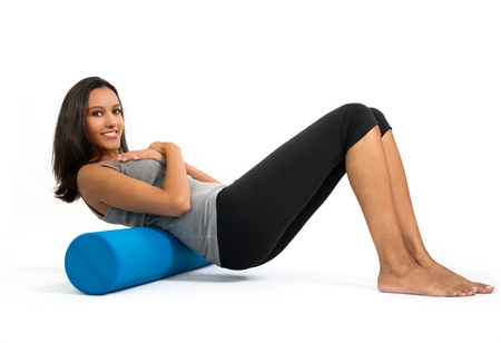 describes: Young woman doing Fascia Muscle Training. Fascia Training describes sports activities and movement exercises that attempt to improve the functional properties of the muscular connective tissues. Stock Photo