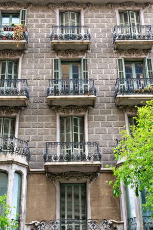 balustrades: Details of the facade of art noveau houses in Barcelona. May 01, 2015 in Barcelona, Spain