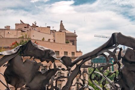 neighboring: View of Neighboring Buildings and Ornate Railing on Rooftop of Casa Mila, Barcelona, Spain