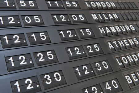 departures board: Close up view of the information detailing the flights on a departures board at an airport terminal in a travel and transport concept