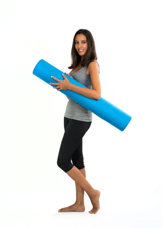describes: Young woman ready to do Fascia Training. Fascia Training describes sports activities and movement exercises that attempt to improve the functional properties of the muscular connective tissues. Stock Photo