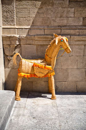 aside: Quaint rustic statue of a horse displayed in Poble Espanyol, Barcelona, Spain, a section of the city set aside as an architectural museum