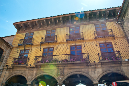 decorative balconies: Exterior building facade in the architectural museum quarter of Poble Espanyol in Barcelona, Spain, with arches and balconies in Art Nouveau style