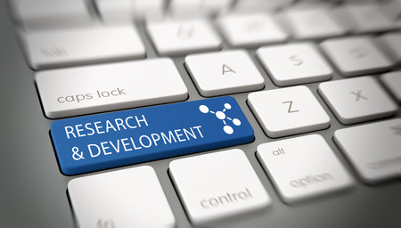 Online Research and Development concept with white text - Research and Development - and an atomic structure icon on a blue enter key on a white computer keyboard viewed high angle with blur vignette