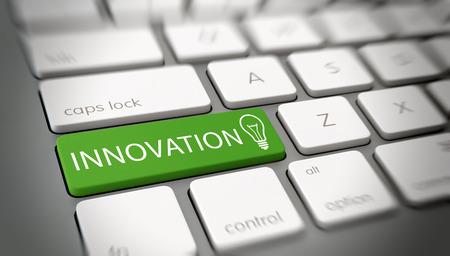 Innovation and originality concept with white text - Innovation - and a light bulb icon on a green enter key on a white computer keyboard viewed at an oblique high angle with blur vignette for focus