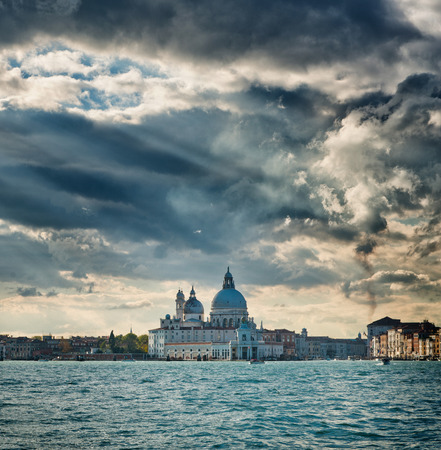 saint marks: Dramatic clouds over Basilica Santa Maria della Salute and the entrance to the Grand Canal viewed over the water from Saint Marks Basin, Italy , Venice