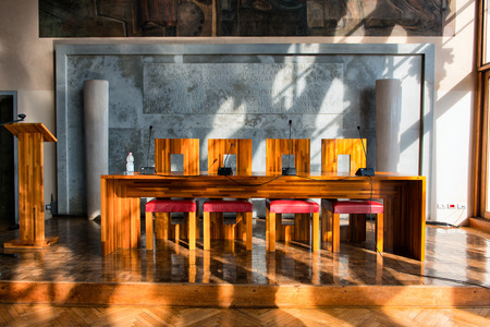 architectural studies: Modern Wooden Table and Chairs Illuminated by Bright Sunlight in Aula Baratto Room at Ca Foscari University of Venice, Italy Editorial