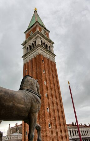 st mark's square: View of the Campanile in Venice against a cloudy grey sky