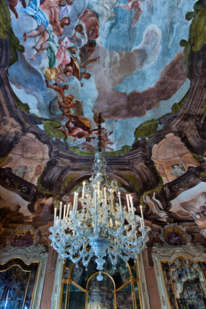 low angle view: Low Angle View of Chandelier Suspended from Ceiling Decorated with Tiepolo Fresco Paintings in Aula Magna Silvio Trentin Room in Palazzo Dofin, Venice, Italy