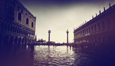 piazza san marco: VENICE, ITALY - 17 OCTOBER 2015: St. Marks Square (Piazza San Marco) during high tide (acqua alta) in Venice, Italy. Acqua alta is an unusual high tide, which floods parts of Venice. October 17 2015. Editorial