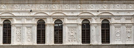 old building facade: Beautiful old white facade at a historic building with stone carvings and decorations