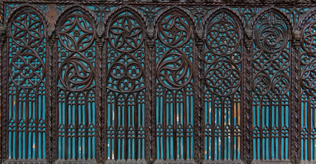 ecclesiastical: Architectural Detail of Blue Windows with Intricate Wood Carving Designs in Historical Santa Maria Gloriosa dei Frari Church Illuminated by Blue Light, Venice, Italy