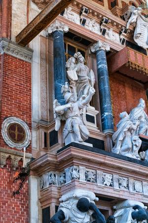 narrative: Low Angle View of Narrative Sculptures as part of Canova Tomb Inside Santa Maria Gloriosa dei Frari Basilica, Venice, Italy Stock Photo