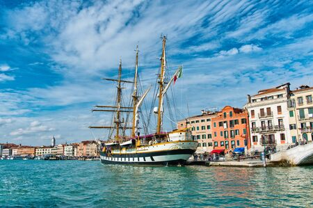 palinuro: View of the three masted barquentine, Palinuro, an Italian navy training ship, moored in front of historic buildings in the Giudecca Canal, Venice, Italy Editorial