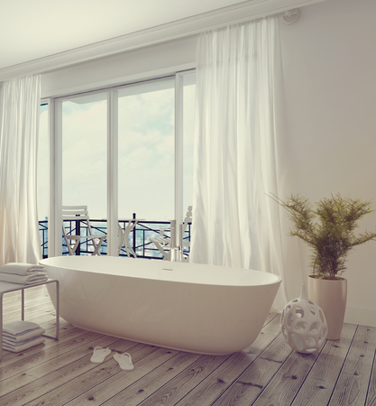Modern stylish white bathroom interior with a free standing tub in front of floor-to-ceiling glass windows leading to a balcony, bright and airy daylight. 3d Rendering.