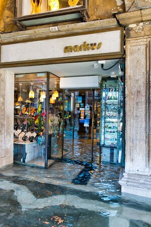 the flood tide: VENICE, ITALY - 17 OCTOBER 2015: Flooded Store near St. Marks Square (Piazza San Marco) during high tide (acqua alta) in Venice, Italy. October 17 2015. Editorial