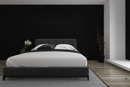 Stylish black and white bedroom inter with a queen size divan style bed and wooden parquet floor lit by daylight from an adjacent window, 3d render