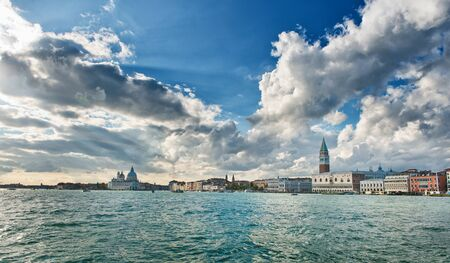 doges  palace: Dramatic clouds above a Venice, Italy cityscape with a view from the Punta della Dogona to the Doges Palace and Campanile viewed over the water Editorial