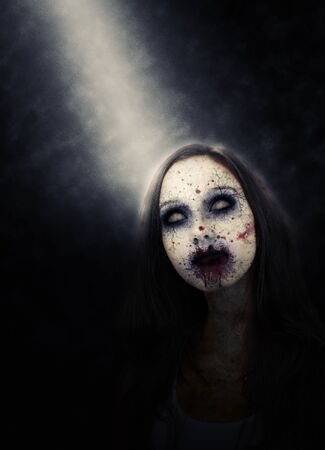 bloodied: Portrait of Zombie Girl with Decayed Face and Blood Splattered Face Lit by Spotlight in Dark Studio with Copy Space
