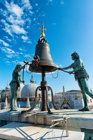 clocktower: VENICE, ITALY - 17 OCTOBER 2015: Torre dellOrologio (St Marks Clocktower) in Venice, Italy. At the top of the tower are two bronze figures which strike the hours on a bell. October 17 2015.