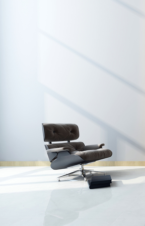 recliner: Modern black maximum comfort recliner chair with footstool in a shaft of sunlight in front of a white wall with copyspace in a home interior. 3d Rendering. Stock Photo