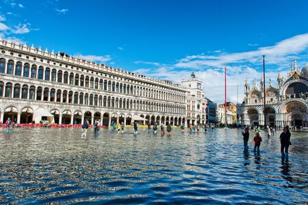 VENICE, ITALY - 17 OCTOBER 2015: St. Marks Square (Piazza San Marco) during high tide (acqua alta) in Venice, Italy. Acqua alta is an unusual high tide, which floods parts of Venice. October 17 2015. Editorial