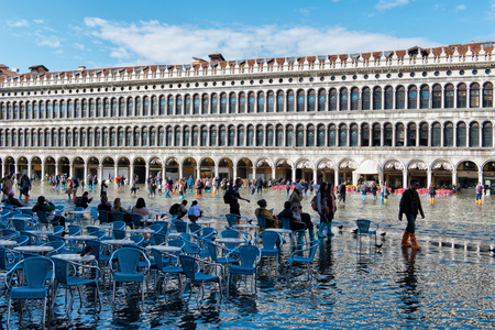 unusually: St. Marks Square (Piazza San Marco) during high tide (acqua alta) in Venice (Venezia), Italy. Acqua alta is an unusually high tide, which rises enough to flood parts of Venice. Editorial