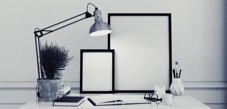 Blank Bilderrahmen auf einem schlichten, modernen Schreibtisch oder Schreibtisch mit einer offenen Zeitschrift und Anglepoise in monochromen schwarzen und weißen Dekor, 3D-Rendering Standard-Bild - 52465037