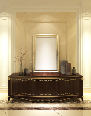 Empty gold frame on a vintage classical mahogany cabinet or kist in an elegant panelled cream and white living room interior, 3d render Stock Photo