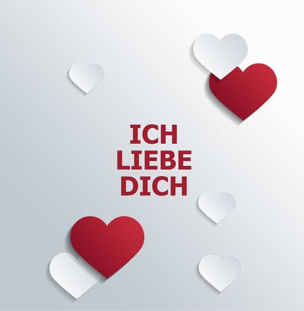 block letters: High Angle View of Message of Love in German Language Printed in Red Block Letters on White Background and Surrounded by Red and White Paper Cut Out Shapes in Various Sizes with Copy Space