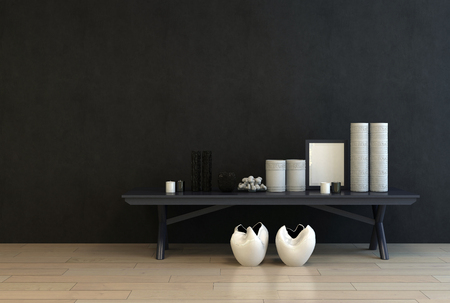 Display of modern ceramics and an empty picture frame on a low black table against a black wall for a dramatic modern interior decor with copy space, 3d rendering