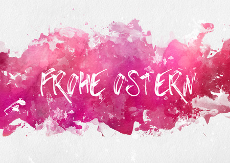 Ostern: Frohe Osten German greeting card design with hand written text on an abstract band of magenta or pink splash effect paint on textured watercolor paper with copy space
