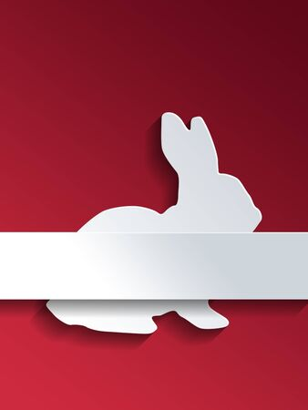 spring out: Cut out sitting rabbit profile on red background with blank label over the middle section