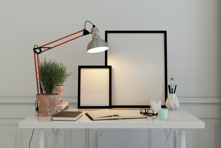 Empty picture frames on a writing desk with an open journal, eyeglasses , potted plant illuminated by an anglepoise lamp, 3d rendering