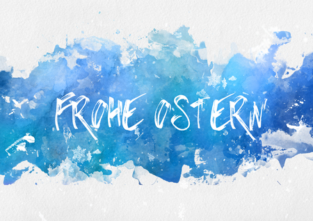 daubed: Frohe Osten, or Happy Easter, greeting card design in German with the hand written text on a painted blue banner on textured watercolor paper with copy space