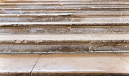 treads: Detail of old worn stone steps with shallow treads in a full frame view Stock Photo
