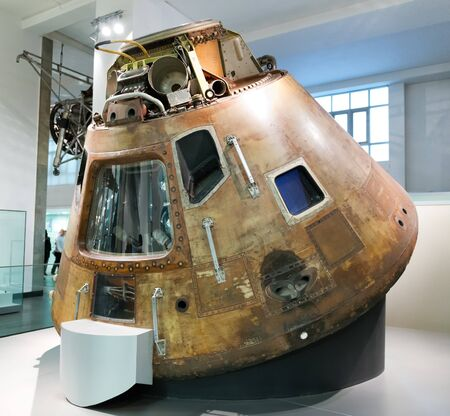apollo: Old 1960s United States space exploration capsule known as Apollo 10 space capsule with view inside on display inside museum