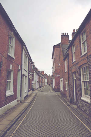 winchester: Narrow street architecture with typical english brick buildings and architecture in Winchester, England.
