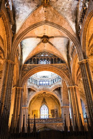 vaulted ceiling: Architectural Interior of Barcelona Cathedral with Arches and Vaulted Ceiling Illuminated in Warm Lighting, Barcelona, Spain