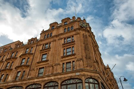 sq: LONDON, UK - FEBRUARY 08, 2016: View of famous department store Harrods (80,000 sq m) in London. First Harrods was opened at 1849 and now it is one of the most famous luxury store in London.