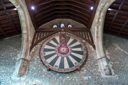 arthur: Spotlights in ceiling on sign of the knights of the round table in the historic medieval castle of Winchester in the United Kingdom