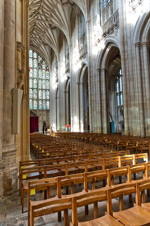 pews: Interior view of the nave of Winchester Cathedral, Winchester, UK showing the high vaulted ceiling and wooden pews